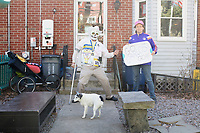 Carlos Arredondo, 57, (left) and his wife Melida Arredondo, 52, are seen in their front yard in Roslindale, Boston, Massachusetts, USA, on Sat., March 31, 2018. Arredondo is well known as the &quot;man in the cowboy hat&quot; who helped out in the aftermath of the Boston Marathon Bombing in 2013. Carlos is wearing a jacket that he has used to create a t-shirt design for when he runs the Boston Marathon later this year. Though he has run the race unofficially previously, this will be the first time he runs it &quot;legally,&quot; he says.<br /> <br /> Their dog, Buddy, age 18, can also be seen. Carlos says he often accidentally calls Buddy by his son's name, Brian. Brian Arredondo died by suicide in 2011 after a battle with depression following the 2004 death of Arrendondo's other son  Marine Lance Corporal Alexander Scott Arredondo, who was killed while serving in Iraq. <br /> <br /> Carlos is wearing a mask and using a crutch as part of a joke between him and his therapist.