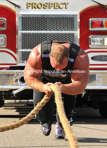 PROSPECT, CT-03 SEPTEMBER 2009-090309JS05-Naugatuck police officer and America's Strong Man, Derek Poundstone, pulls a Prospect Firetruck down Center Street in Prospect on Thursday in preparation for the American's Strong Man competition.  <br /> Jim Shannon Republican-American