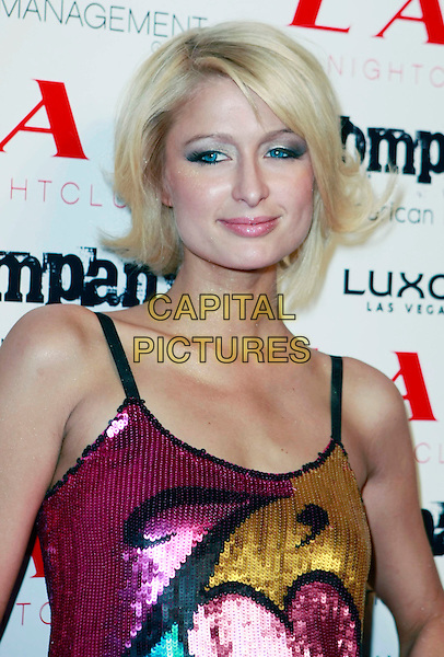 PARIS HILTON.Paris Hilton and Nicky Hilton host LAX Nightclub's New Year's Eve Bash held at the LUXOR Hotel and Casino Las Vegas, Las Vegas, Nevada, USA, 31 December, 2007..portrait headshot pink gold blue turquoise sequined dress .CAP/ADM/MJT.©MJT/AdMedia/Capital Pictures.