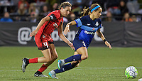 Portland, Oregon - Saturday July 9, 2016: FC Kansas City forward Shea Groom (2) dribbles past Portland Thorns FC defender Emily Menges (4) during a regular season National Women's Soccer League (NWSL) match at Providence Park.