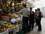 Hong Kong urban scene - police on partol stop at a street side shop