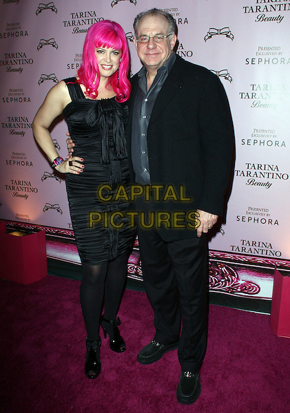 "TARINA TARANTINO & DAVID SULITEANU, Sephora CEO.Attending the Launch of The ""Tarina Tarantino Beauty"" Cosmetic Collection presented Exclusively at Sephora,.Hollywood, California, USA,.24th February 2010..full length black hand on hip ruched dress tights coat grey gray shirt .CAP/ADM/KB.©Kevan Brooks/AdMedia/Capital Pictures."