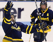 Joe Cucci (Merrimack - 14) celebrates his first of three goals in the game which tied the game at 2.  Cucci also earned an assist on the remaining Merrimack goal. - The visiting Merrimack College Warriors defeated the Northeastern University Huskies 4-3 (OT) on Friday, February 4, 2011, at Matthews Arena in Boston, Massachusetts.