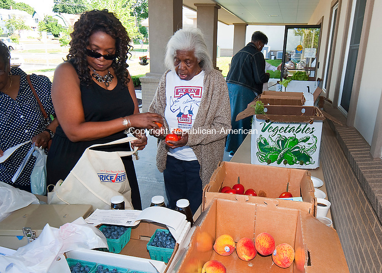 WATERBURY, CT--- -071615JS02-- Anita Brown, left,  and her 91-year old mother Isabella Brown, both from Waterbury, pick out vegetables during a stop at the Brass City Harvest farmers market Thursday at the Waterbury Senior Center. The Brass City Harvest sets up the market  which allows seniors to get fresh food while suing state-funded coupons. They also offer demonstrations on making items with fresh fruits and vegetables. <br /> Jim Shannon Republican-American