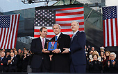 New York, NY - November 11, 2008 -- United States President Charles de Gunzburg, United States President George W. Bush and Richard Santulli (L) stand while President Bush holds the Intrepid Freedom Award at the rededication ceremony of the Intrepid Sea, Air and Space Museum in New York City on Tuesday, November 11, 2008. <br /> Credit: John Angelillo - Pool via CNP