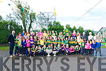 Scoil Cheann Tra pupils and teachers welcoming Kerry players Marc Ó Sé and Brian Rael (minors) bringing Sam Maguire and Tom Markham cups to the school on Wednesday.