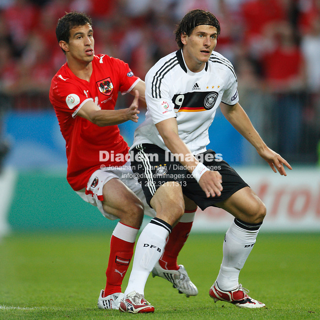 VIENNA - JUNE 16:  György Garics of Austria (14) and Mario Gómez of Germany (9) anticipate the ball during a UEFA Euro 2008 Group B match at Ernst Happel Stadion June 16, 2008 in Vienna, Austria.  (Photograph by Jonathan P. Larsen)