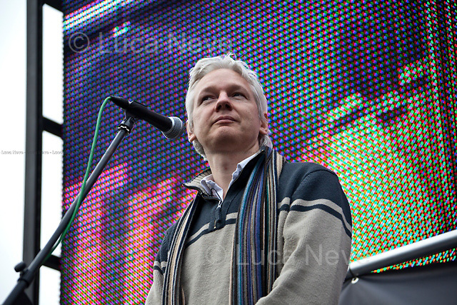 Julian Assange (Australian publisher, journalist, media and internet entrepreneur, media critic, writer, computer programmer and political/internet activist, editor in chief and founder of WikiLeaks).<br /> <br /> London, 08/10/2011. Today Trafalgar Square was the stage of the &quot;Antiwar Mass Assembly&quot; organised by The Stop The War Coalition to mark the 10th Anniversary of the invasion of Afghanistan. Thousands of people gathered in the square to listen to speeches given by journalists, activists, politicians, trade union leaders, MPs, ex-soldiers, relatives and parents of soldiers and civilians killed during the conflict, and to see the performances of actors, musicians, writers, filmmakers and artists. The speakers, among others, included: Jeremy Corbin, Joe Glenton, Seumas Milne, Brian Eno, Sukri Sultan and Shadia Edwards-Dashti, Hetty Bower, Mark Cambell, Sanum Ghafoor, Andrew Murray, Lauren Booth, Kate Hudson, Sami Ramadani, Yvone Ridley, Mark Rylance, Dave Randall, Roger Lloyd-Pack, Rebecca Thorn, Sanasino al Yemen, Elvis McGonagall, Lowkey (Kareem Dennis), Tony Benn, John Hilary, Bruce Kent, John Pilger, Billy Hayes, Alison Louise Kennedy, Joan Humpheries, Jemima Khan, Julian Assange, Lindsey German, George Galloway. At the end of the speeches a group of protesters marched toward Downing Street where after a peaceful occupation the police made some arrests.