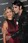 Spanish actress Elsa Pataky, left, and Spanish angent and showman Mario Vaquerizo pose for photographers during the premiere of the fashion film 'Dark Seduction' in Madrid, Spain. November 5, 2014. (ALTERPHOTOS / Nacho Lopez)