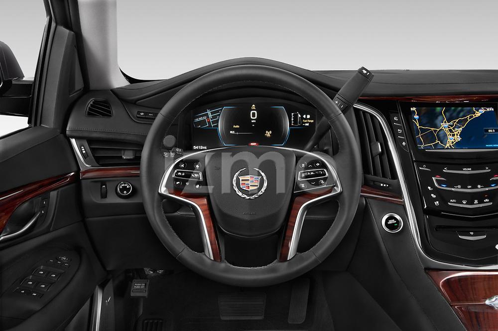 Car pictures of steering wheel view of a 2015 Cadillac Escalade ESV 2WD Luxury 5 Door SUV Steering Wheel