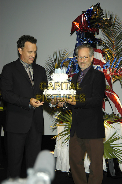 TOM HANKS & STEPHEN SPEILBERG.Deauville Film Festival, France, 4th September 2004..half length cake.Ref: PL.www.capitalpictures.com.sales@capitalpictures.com.©Capital Pictures.