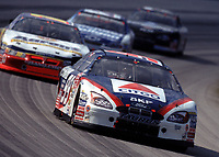 Jeff Burton leads a pack of cars through turn 2 during the Pennzoil 400 at Homestead-Miami Speedway in November 2000. (Photo by Brian Cleary)