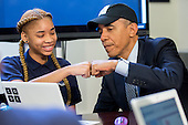 """United States President Barack Obama fist-bumps middle-school student Adrianna Mitchell while participating in an """"Hour of Code"""" event in the Eisenhower Executive Office Building next to the White House in Washington, D.C., U.S., on Monday, December 8, 2014. The event is in honor of Computer Science Education Week. <br /> Credit: Andrew Harrer / Pool via CNP"""
