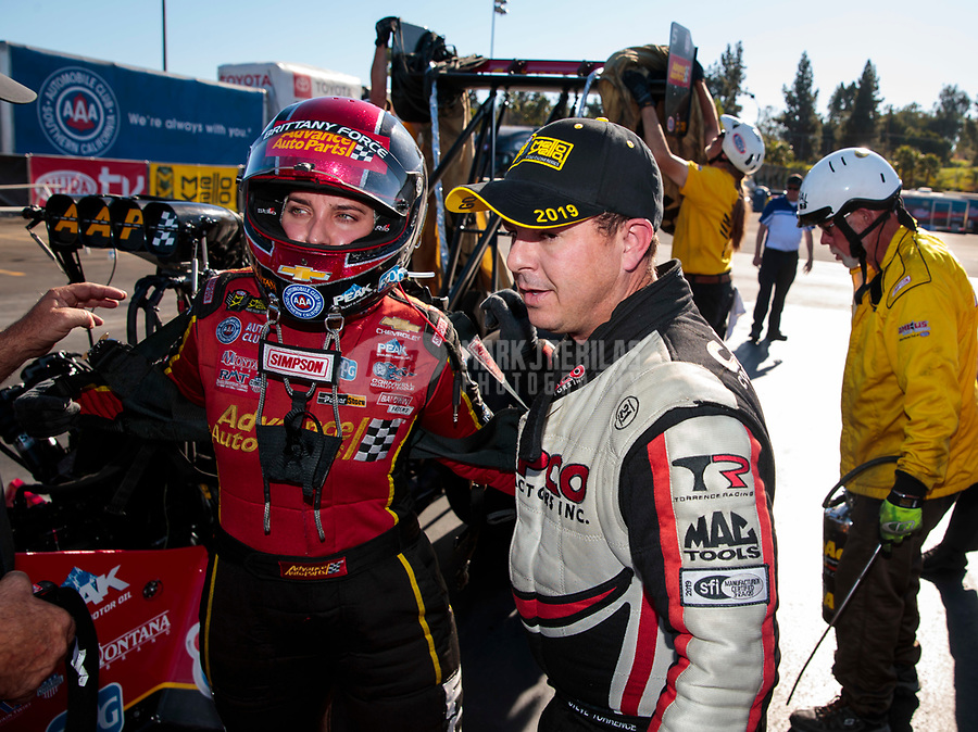 Nov 17, 2019; Pomona, CA, USA; NHRA top fuel driver Steve Torrence (right) with Brittany Force during the Auto Club Finals at Auto Club Raceway at Pomona. Mandatory Credit: Mark J. Rebilas-USA TODAY Sports