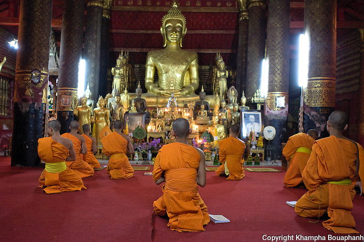 Novice monks attend evening prayers at Wat Mai in Luang Prabang, Laos on November 5, 2009.   (Photo by Khampha Bouaphanh)
