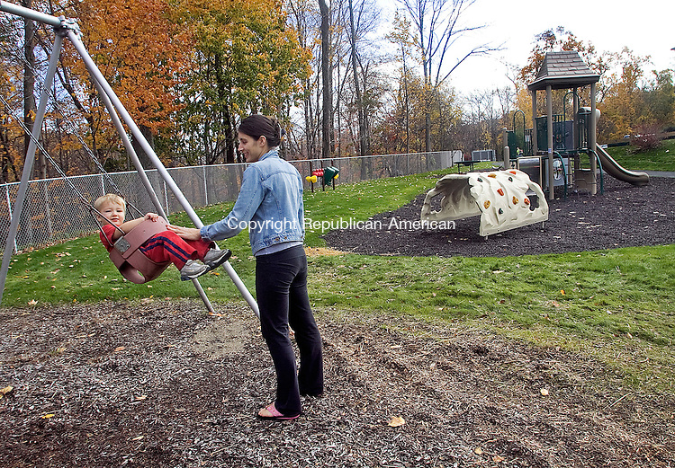 MIDDLEBURY CT.-28 OCTOBER 2010 102810DA07- Diana Holloway of Middlebury pushes her son Parker Keane, 23 months, on the swing at Shepardson Community Center Park in Middlebury on Thursday.  The town's Public Works Department has completed work on a new handicapped-accessible playground outside of the Shepardson Community Center. Now the department is busy finishing the Mary I. Johnson Park on Maple Drive.<br /> Darlene Douty Republican-American