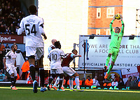 Pictured: Goalkeeper Adrian of West Ham (R) catches the ball, Wilfried Bony of Swansea (10) looks on. 01 February 2014<br />