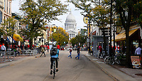 People bike and walk up State Street in front of the State Capitol on Saturday, October 3, 2015 in Madison, Wisconsin