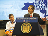 New York State Governor Andrew Cuomo addresses the media as New York Islanders captain John Tavares, seated, listens to him during a news conference at Nassau Coliseum on Monday, Jan. 29, 2018. Cuomo announced the site will host a portion of Islanders home games over the next three seasons as the team's new arena at Belmont is being constructed.