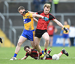 Eoin Cleary of  Clare in action against Gerard Mc Govern and Conaill Mc Govern of Down during their Division 2, Round 2 National League game at Cusack Park. Photograph by John Kelly.