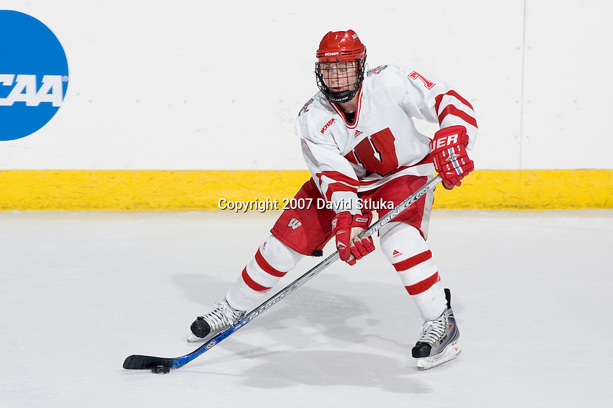 MADISON, WI - MARCH 10: Meghan Duggan #7 of the Wisconsin Badgers women's hockey team handles the puck against the Harvard Crimson during their NCAA tournament game at the Kohl Center on March 10, 2007 in Madison, Wisconsin. The Badgers beat the Crimson 1-0 in the 4th overtime. (Photo by David Stluka)