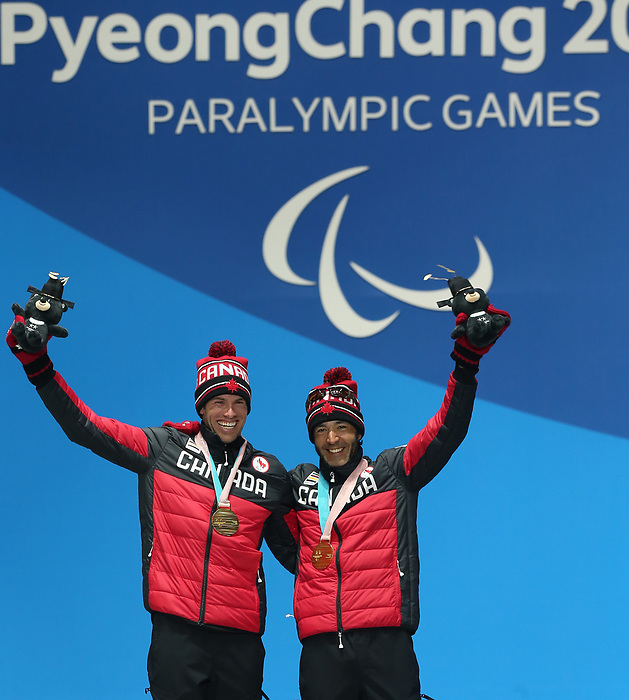Pyeongchang, Korea, 14/3/2018- Brian McKeever and Russell Kennedy receive gold medals at the 2018 Paralympic Games in PyeongChang. Photo Scott Grant/Canadian Paralympic Committee.