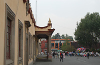 """Coyoacan, Mexico City - The old City Hall in Coyoacan, also known as home of Hernán Cortés -seen here on the left side- overlooks Villa Coyoacan Plaza. Coyoacan's name comes from Nahuatl it likely meaning """"place of coyotes"""".  Hernán Cortes and the Spanish conquistadors used this area as a headquarters during the Spanish conquest of the Aztec Empire. They also made it the first capital of New Spain between 1521 and 1523.  In recent times, has been a counterculture hotbed and where Frida Kahlo and Diego Rivera lived, a few blocks away from Leon Trotsky.  Due the historic and cultural relevance, their homes are now the Frida Kahlo Museum and the Leon Trotsky Museum, which are visited by thousands of tourists every year.  Modern-day Coyoacan is a quiet residential area with cobblestone streets, restaurants, parks, squares, and a favorite hangout for bohemia enthusiasts.  Photo by Eduardo Barraza © Copyright"""