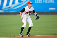 Shortstop Zach Kozart #8 of the Carolina Mudcats on defense versus the Birmingham Barons at Five County Stadium August 15, 2009 in Zebulon, North Carolina. (Photo by Brian Westerholt / Four Seam Images)