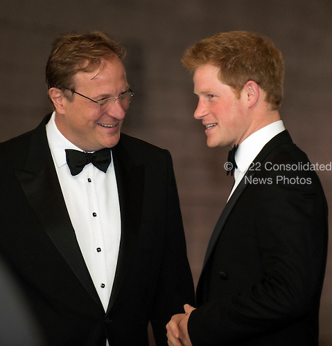 Prince Harry arrives at the Ritz-Carlton Hotel for the Atlantic Council Dinner in Washington, D.C. on Monday, May 7, 2012.  He was greeted by Atlantic Council CEO Frederick Kempe..Credit: Ron Sachs / CNP