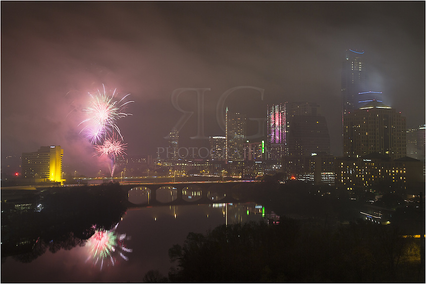 Fog loomed over downtown Austin on this end to 2012. The New Year's Eve 2013 fireworks show still shined its way through the low hanging clouds. From the Hyatt on the left to the tallest building in Austin (the Austonian) on the right, folks gathered in all places in between to watch the show. The fireworks were launched from the shores of Ladybird Lake and revelers watched from both Auditorium Shores and from the 1st Street and Congress Bridges.