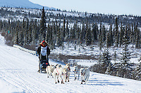 Jimmy Lanier and team run down the trail on the Denali Highway with the Alaska Range in the background during the start day of the 2015 Junior Iditarod on Sunday March 1, 2015<br /> <br /> <br /> <br /> (C) Jeff Schultz/SchultzPhoto.com - ALL RIGHTS RESERVED<br />  DUPLICATION  PROHIBITED  WITHOUT  PERMISSION