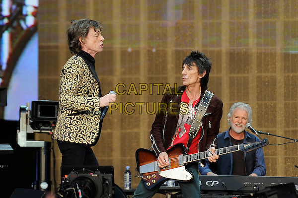 Mick Jagger and Ronnie Wood of The Rolling Stones <br /> performing at Barclaycard British Summertime, Hyde Park, London, England, UK, <br /> 13th July 2013.<br /> music concert gig festival live on stage  half length microphone gold black patterned blazer jacket side playing guitar <br /> CAP/MAR <br /> &copy; Martin Harris/Capital Pictures