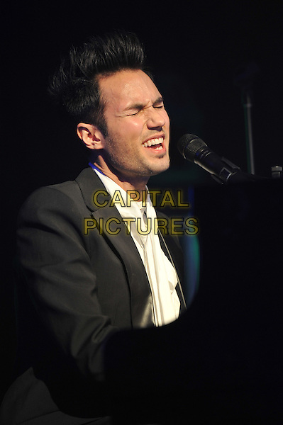 A Guest.'Global Angels Awards', The Park Plaza Hotel, Westminster, London, England. 2nd December 2011..music on stage live concert gig performing half length microphone   singing playing piano black suit white shirt .CAP/MAR.© Martin Harris/Capital Pictures.