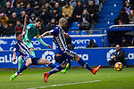 FC Barcelona's forward Leo Messi scored while Club Deportivo Alaves'es midfielder Carlos Vigaray and defender Victor Laguardia Cisneros competes for the ball during the match of La Liga between Deportivo Alaves and Futbol Club Barcelona at Mendizorroza Stadium in Vitoria, Spain. February 11, 2017. (ALTERPHOTOS/Rodrigo Jimenez)
