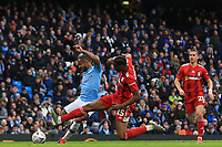 26th January 2020; Etihad Stadium, Manchester, Lancashire, England; English FA Cup Football, Manchester City versus Fulham; Terence Kongolo of Fulham blocks a shot from Raheem Sterling of Manchester City