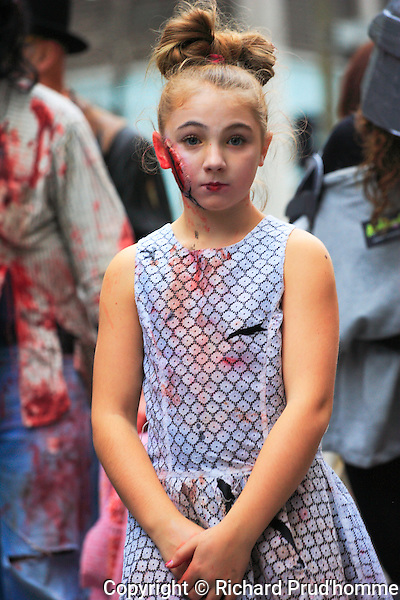 A young girld posing before the start of the Zombie walk parade in Montreal