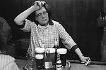 An exhausted member of the bar staff,  Saturday night at Byker & St. Peters Working Men's Social Club Newcastle upon Tyne, Tyne and Wear northern England 1973