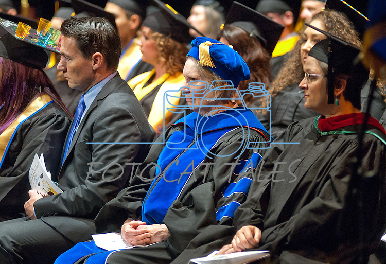 Angelo DePerez, left, 2014-15 President Associated Students of Western Nevada College, Dr. Doris Dwyer and Susan Priest, Chair, Academic Faculty Senate listen to the commencement address at the Western Nevada College commencement in Fallon, Nev., on Tuesday, May 20, 2014. <br /> Photo by Kim Lamb
