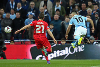 Sergio Aguero of Manchester City (right) shoots during the Capital One Cup match between Liverpool and Manchester City at Wembley Stadium, London, England on 28 February 2016. Photo by David Horn / PRiME Media Images.