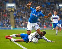 Nathan Thompson of Portsmouth is foiled by Ethan Ebanks-Landell of Rochdale and a penalty is given  during Portsmouth vs Rochdale, Sky Bet EFL League 1 Football at Fratton Park on 13th April 2019