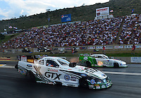 Jul, 20, 2012; Morrison, CO, USA: NHRA funny car driver Mike Neff (near) races alongside Jack Beckman during qualifying for the Mile High Nationals at Bandimere Speedway. Mandatory Credit: Mark J. Rebilas-US PRESSWIRE