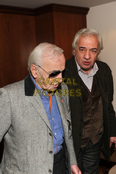 Charles Aznavour.press conference in Moscow, Russia..December 10th, 2011.half length profile looking down blue shirt grey gray sunglasses shades .CAP/PER/AL.©AL/PersonaStars/CapitalPictures