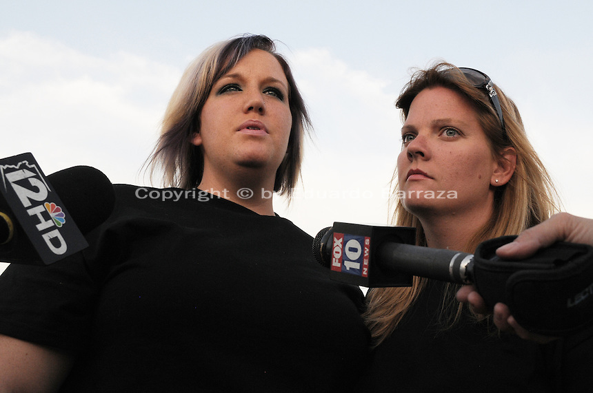 "Gilbert, Arizona – Friends and family of the Mederos Family gathered to hold a memorial for the four victims of the Gilbert Massacre occurred on May 2, 2012. According to Gilbert Police, Lisa Mederos, Amber Mederos, baby Lilly Mederos, and Jim Hiott (Amber's fiancé) were all killed by notorious white supremacist and Neo-Nazi Jason ""J.T."" Ready before taking his own life. In this image, Crystal Seibert (left) and Mistie Whiteman talk to members of the media about the Mederos family: Lisa Mederos, Amber Mederos, baby Lilly Mederos and Jim Hiott. Photo by Eduardo Barraza © 2012"