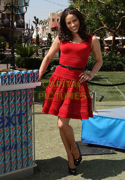 "Paula Patton.Paula Patton Invites Fans To Sample New Pepsi Next For ""Drink It To Believe It"" Campaign Held at The Grove, Los Angeles, California, USA..April 9th, 2012.full length red sleeveless dress black belt hand on hip.CAP/ADM/KB.©Kevan Brooks/AdMedia/Capital Pictures."