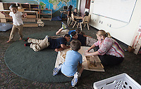 NWA Democrat-Gazette/J.T. WAMPLER Teacher Katherine Robinson works with students Thursday Sept. 3, 2015 Ozark Montessori Academy at the Jones Center in Springdale.