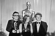 April 10th 1972, Los Angeles, California, USA. French music composer Michel Legrand holding his Oscar for Best Original Score, for the music of the film Summer of '42 directed by Robert Mulligan at the 44th Academy Awards.  Also present are American actors Cloris Leachman (C) and Timothy Bottoms who starred in The Last Picture Show. Leachman was awarded the Best Supporting Actress Oscar for her role.