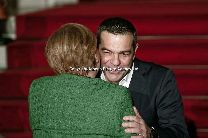 Pictured: German Chancellor Angela Merkel is greeted Greek Prime Minister Alexis Tsipras outside Maximou Mansion (Megaro Maximou) in Athens, Greece.<br /> Re: Official visit of German Chancellor Angela Merkel  to Athens, Greece.