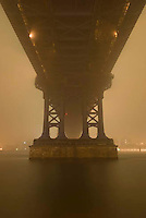 AVAILABLE EXCLUSIVELY FROM GETTY IMAGES<br /> <br /> Please search for image # 83397181 at www.gettyimages.com to license and download this image<br /> <br /> Upward View of the Support Structure of the Manhattan Bridge on a Foggy Night, East River, Lower Manhattan<br /> <br /> New York City, New York State, USA