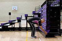 17 OCT 2009 - LOUGHBOROUGH, GBR - A member of Loughborough staff prepares the bleacher seating in the Sir David Wallace New Sports Hall for the Team England v Japan International (PHOTO (C) NIGEL FARROW)