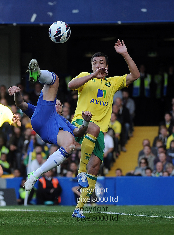 Fernado Torres of Chelsea challenges Leon Barnet of Norwich City during the Barclay's Premier League match between Norwich City and Chelsea at the Stamford Bridge on Saturday 06 October, 2012 in London, England. Picture Zed Jameson/pixel 8000 ltd